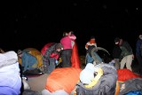Setting up mattresses and sleeping bags outside to attend the night sky lecture